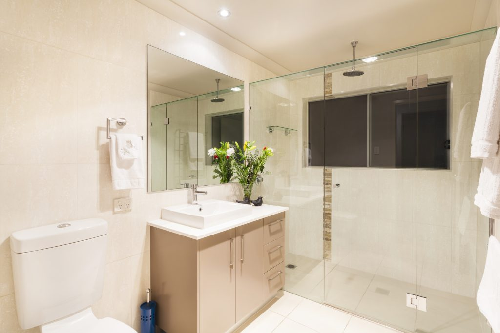 Modern bathroom interior with toillet, sink and shower
