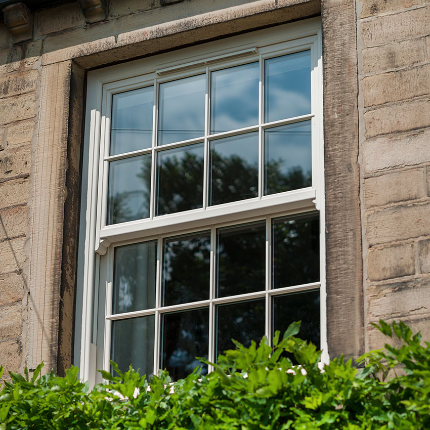 White uPVC sliding sash window glazing