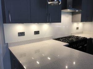 navy modern kitchen with marble countertops