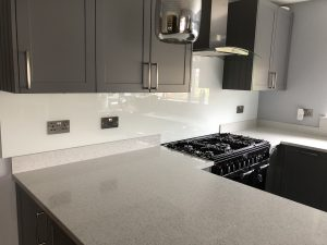 grey modern kitchen with marble countertops